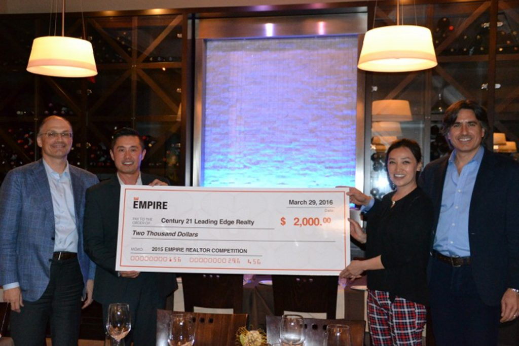 Good Luk Team members Shirley CHau and Louie Luk receiving empire realtor award